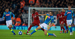 LIVERPOOL, ENGLAND - Tuesday, December 11, 2018: Liverpool's Sadio Mane is tackled by Napoli's Nikola Maksimović during the UEFA Champions League Group C match between Liverpool FC and SSC Napoli at Anfield. (Pic by David Rawcliffe/Propaganda)