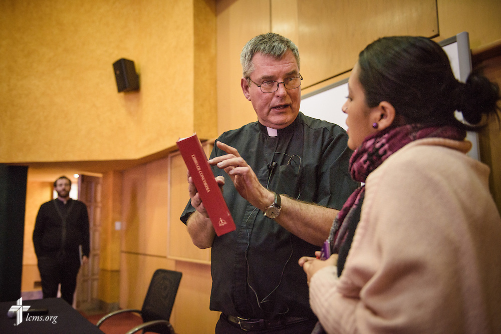 The Rev. Daniel Conrad, LCMS missionary to Mexico, chats with Esperanza Rodriguez following a talk on Lutheranism at a Catholic Augustinian seminary on Friday, Jan. 13, 2017, in Mexico City. Behind Conrad is the Rev. Andrew Schlund, fellow LCMS missionary. LCMS Communications/Erik M. Lunsford