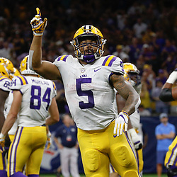 Sep 2, 2017; New Orleans, LA, USA; LSU Tigers running back Derrius Guice (5) celebrates a touchdown against the Brigham Young Cougars during the second quarter of the AdvoCare Texas Kickoff game at the Mercedes-Benz Superdome. Mandatory Credit: Derick E. Hingle-USA TODAY Sports