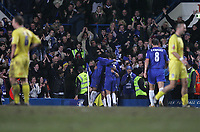 Photo: Lee Earle.<br /> Chelsea v Colchester United. The FA Cup. 19/02/2006. Chelsea players (C) congratulate Joe Cole after he scored their second as the Colchester  players look dejected.