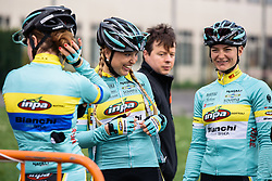 Sarah Olsson shares a joke with her INPA teammates ahead of sign in - Grand Prix de Dottignies 2016. A 117km road race starting and finishing in Dottignies, Belgium on April 4th 2016.