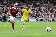 AFC Wimbledon striker Andy Barcham (17) and Northampton Town defender Aaron Phillips (18) during the EFL Sky Bet League 1 match between Northampton Town and AFC Wimbledon at Sixfields Stadium, Northampton, England on 20 August 2016. Photo by Stuart Butcher.