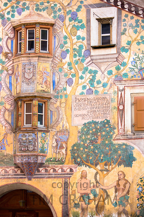 Adam and Eve mural and Romansch inscription in Engadine Valley village of Ardez with painted 17th Century houses, Switzerland
