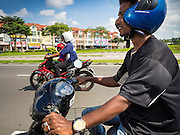 03 JUNE 2015 - KULAI, JOHORE, MALAYSIA: MOHAMMAD RAFIQ, a Rohingya refugee from Myanmar rides his motorcycle home after a day of picking up empty plastic bottles on the side of Malaysian highways. He said he makes about 1,000 Malaysian Ringgit a month (about $270 US). He came to Malaysia as refugee, this menial work is the only work he can find. The UN says the Rohingya, a Muslim minority in western Myanmar, are the most persecuted ethnic minority in the world. The government of Myanmar insists the Rohingya are illegal immigrants from Bangladesh and has refused to grant them citizenship. Most of the Rohingya in Myanmar have been confined to Internal Displaced Persons camp in Rakhine state, bordering Bangladesh. Thousands of Rohingya have fled Myanmar and settled in Malaysia. Most fled on small fishing trawlers. There are about 1,500 Rohingya in the town of Kulai, in the Malaysian state of Johore. Only about 500 of them have been granted official refugee status by the UN High Commissioner for Refugees. The rest live under the radar, relying on gifts from their community and taking menial jobs to make ends meet. They face harassment from Malaysian police who, the Rohingya say, extort bribes from them.    PHOTO BY JACK KURTZ