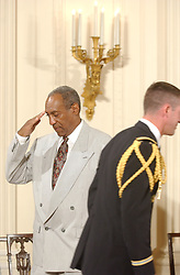 Bill Cosby admires his Presidential Medal of Freedom that he received from United States President George W. Bush during a ceremony in the East Room of the White House in Washington, D.C. on July 9, 2002..Credit: Ron Sachs / CNP. 09 Jul 2002 Pictured: Bill Cosby salutes his escort as he takes his seat prior to the ceremony where U.S. President George W. Bush honored the recipients of the Presidential Madal of Freedom during a ceremony in the East Room of the White House in Washington, D.C. on July 9, 2002..Credit: Ron Sachs / CNP. Photo credit: Ron Sachs / CNP / MEGA TheMegaAgency.com +1 888 505 6342