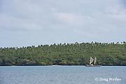 traditional double-hulled Polynesian voyaging canoe or waka, Hine Moana, crosses Hunga Lagoon on its way to Hunga Village, Hunga Island, Vava'u, Kingdom of Tonga, South Pacific