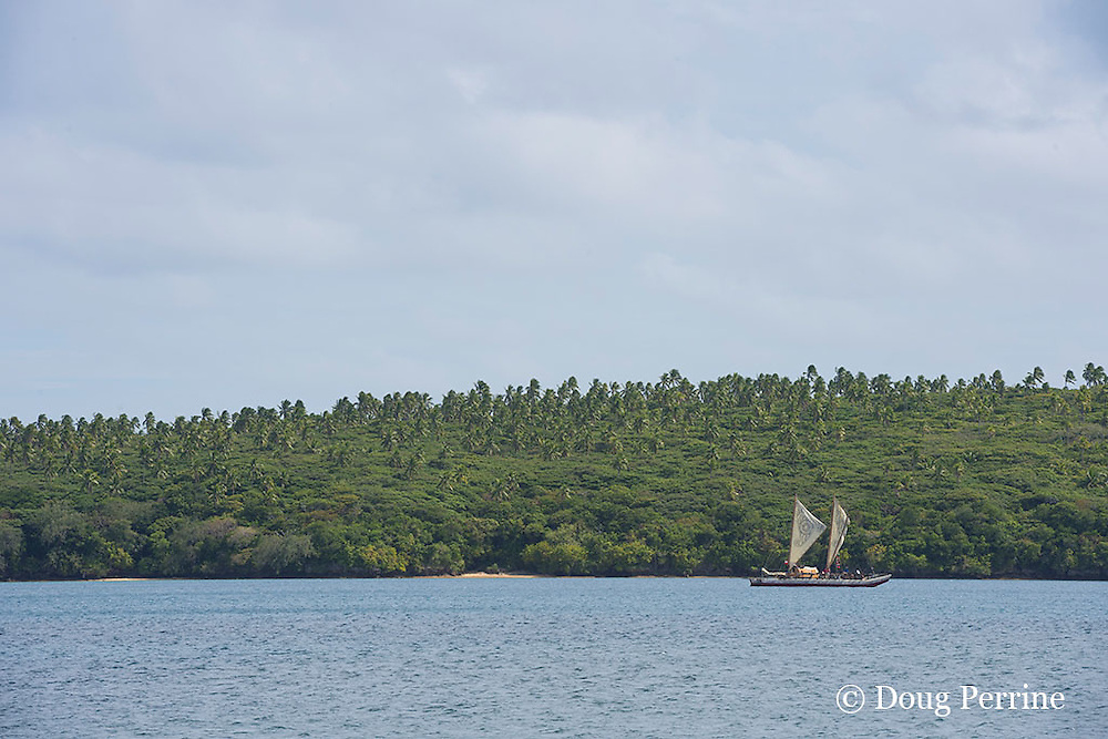 traditional double-hulled Polynesian voyaging canoe or waka, Hine Moana, crosses Hunga Lagoon on its way to Hunga Village, Hunga Island, Vava'u, Kingdom of Tonga, South Pacific