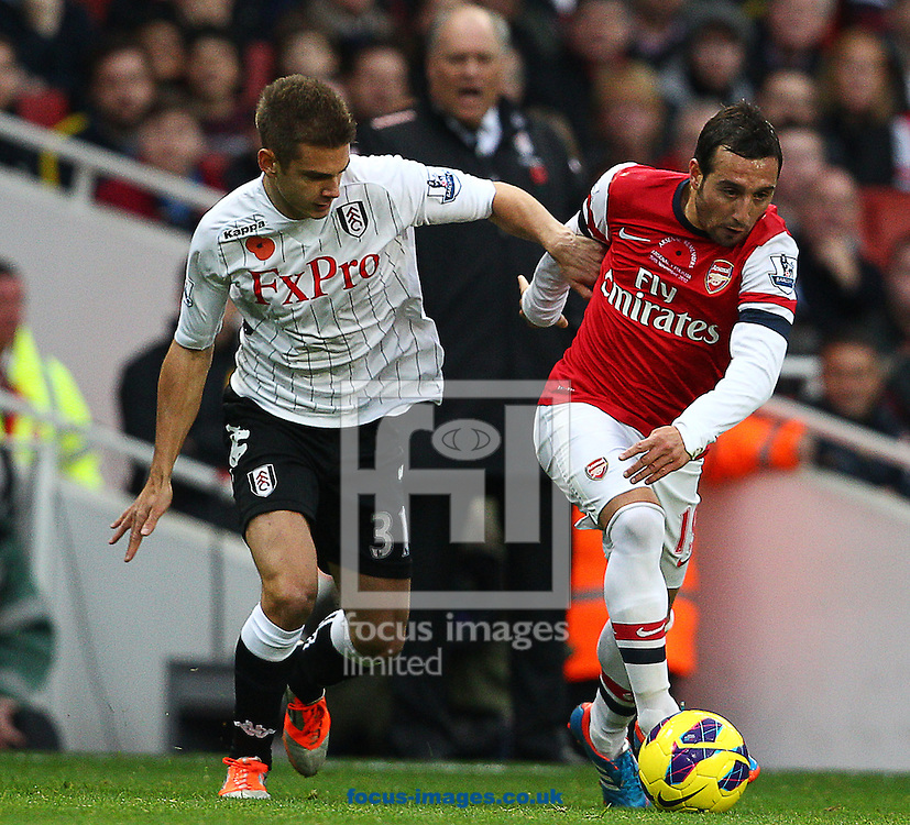 Picture by Paul Terry/Focus Images Ltd +44 7545 642257.10/11/2012.Santi Cazorla of Arsenal and Alex Kacaniklic of Fulham during the Barclays Premier League match at the Emirates Stadium, London.