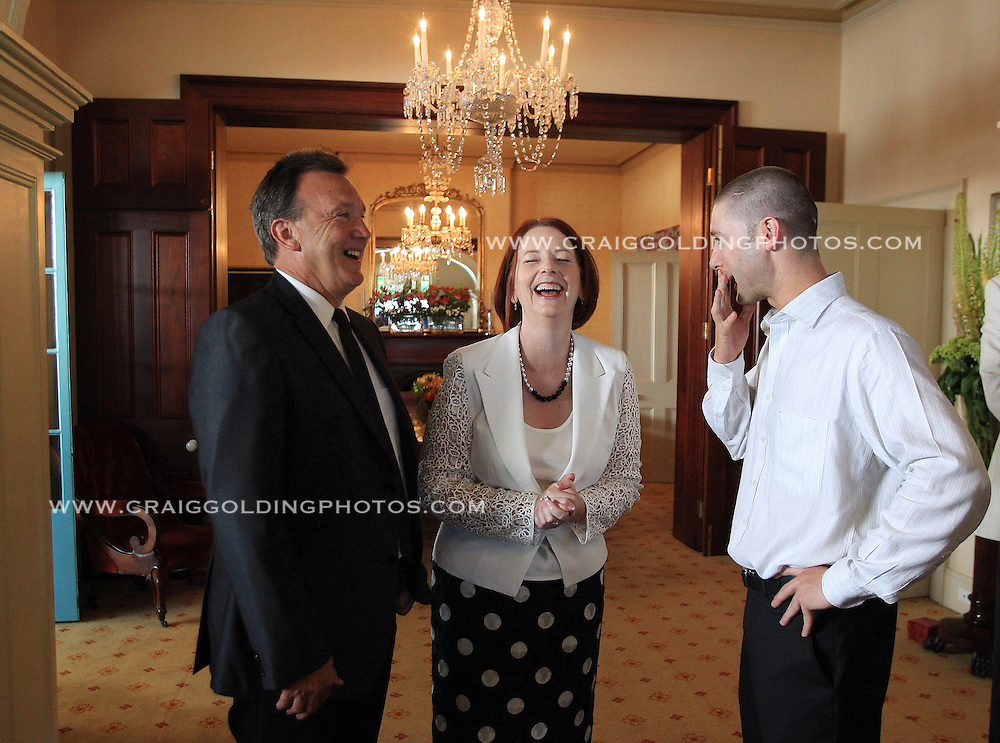 Australia's Prime Minister Julia Gillard and her partner Tim Mathieson greet Australia's Michael Clarke who has been named captain for the final Ashes test at the S.C.G. replacing the injured Ricky Ponting.The Australian and English cricket teams attended a function at Kirribilli House with the Prime Minister on January 1, 2011 in Sydney, Australia. <br />