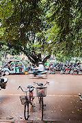 Bicycles, motorcycles and tuk-tuks along Pokambor Avenue, Siem Reap