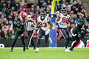 Houston Texans Running Back Carlos Hyde (23) in action during the International Series match between Jacksonville Jaguars and Houston Texans at Wembley Stadium, London, England on 3 November 2019.