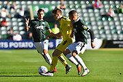 Jake Hesketh (8) of Burton Albion battles for possession with Stuart O'Keefe (13) of Plymouth Argyle during the EFL Sky Bet League 1 match between Plymouth Argyle and Burton Albion at Home Park, Plymouth, England on 20 October 2018.