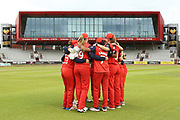 Lancashire Thunders team huddle during the Women's Cricket Super League match between Lancashire Thunder and Loughborough Lightning at the Emirates, Old Trafford, Manchester, United Kingdom on 20 August 2019.
