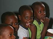 TEA TIME AT KONDANANI CHILDRENS ORPHANAGE IN BLANTYRE MALAWI SOUTH EASTERN AFRICA.23.11.06.PIX STEVE BUTLER
