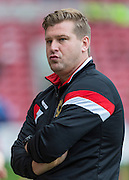 Karl Robinson (Manager) looks pensive before the Sky Bet Championship match between Middlesbrough and Milton Keynes Dons at the Riverside Stadium, Middlesbrough, England on 12 September 2015. Photo by George Ledger.