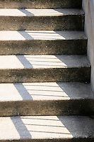 Concrete stairway with shadow pattern on it.