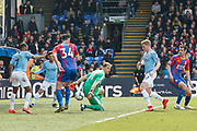 Manchester City midfielder Kevin De Bruyne (17) kicks the ball towards goal past Crystal Palace defender Scott Dann (6) and Crystal Palace goalkeeper Vicente Guaita (31) during the Premier League match between Crystal Palace and Manchester City at Selhurst Park, London, England on 14 April 2019.