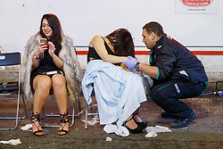 © Licensed to London News Pictures. 01/01/2016. London, UK. Drunk revellers being treated at a temporary treatment centre in central London at the first hours of 2016 on January 1, 2016. Photo credit: Tolga Akmen/LNP