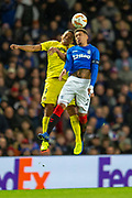 Carlos Bacca (#9) of Villarreal CF and James Tavernier (#2) of Rangers FC contest a header during the Europa League group stage match between Rangers FC and Villareal CF at Ibrox, Glasgow, Scotland on 29 November 2018.