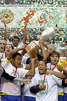 25/07/04 - LIMA - PERU -  COPA AMERICA PERU 2004 -  BRASIL - BRAZIL (5) win by penalty  over ARGENTINA (3) - BRAZIL CHAMPION CELEBRATION.<br />Brazilian Player receiving the cup and celebrating.<br />©G.P./Argenpress.com
