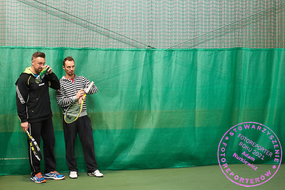 (L) Bartlomiej Dabrowski trainer assistant and former tennis player and (R) Radoslaw Szymanik trainer coach and captain of Polish Davis Cup Team during training session while Polish Tennis Association Davis Cup Team Training Camp at Deski Tennis Club in Warsaw, Poland.<br /> <br /> Poland, Warsaw, December 18, 2014<br /> <br /> Picture also available in RAW (NEF) or TIFF format on special request.<br /> <br /> For editorial use only. Any commercial or promotional use requires permission.<br /> <br /> Mandatory credit:<br /> Photo by &copy; Adam Nurkiewicz / Mediasport
