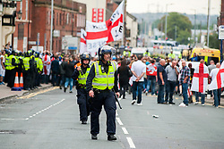 "Rotherham England<br /> 13 September 2014 <br /> Police Officers in riot kit try to get EDL members and Supporters back onto the official route after the EDL broke through a police cordon during the English Defence League Justice for the Rotherham 1400 March described by an EDL Facebook Page as ""a protest against the Pakistani Muslim grooming gangs"" on Saturday Afternoon <br /> <br /> <br /> Image © Paul David Drabble <br /> www.pauldaviddrabble.co.uk"