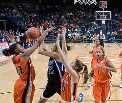 Duke Blue Devils Guard Lindsey Harding (10) blocks a shot from Virginia Cavaliers Guard Monica Wright (22).  The University of Virginia Cavaliers lost to the #1 ranked Duke University Blue Devils 76-61 at the John Paul Jones Arena in Charlottesville, VA on February 2, 2007.