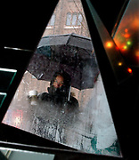 Cit1/3/03  Photo by Mara Lavitt-Snow reflect<br /> ML0044I #5449<br /> Robin Rocca of Branford walks back to work after lunch break in downtown New Haven.  Rocca is reflected in part of a glass sculpture by Branford artist Joy Wulke.