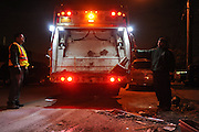 Daniel Ruotilio of Bay Terrace and Jason Tafuri of South Beach begin a twelve hour overnight shift with the Department of Sanitation New York picking up the mountains of debris left on the curbs of Staten Island following the clean-up of Hurricane Sandy, Nov. 2, 2012. Ruotilio commented that the mental strain of disposing of four tons a night of people's possessions was harder to cope with than the physical task.