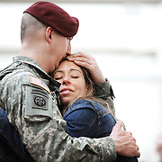 Sergeant Coy Hurley, of the as the 82nd Combat Aviation Brigade, 82nd Airborne Division, is welcomed home by Kimberly Fanning after returning from a year-long deployment in Afghanistan, at Pope Air Force base March 16, 2010 in Fort Bragg, North Carolina. The unit provided full-spectrum aviation operations in southern Afghanistan and played a key role under heavy fire in the major assault on Marjah last month.