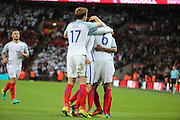 England defender, Chris Smalling (06) celebrating scoring opening goal 1-0 during the Friendly International match between England and Portugal at Wembley Stadium, London, England on 2 June 2016. Photo by Matthew Redman.