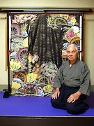 Junsaku Yoshihara sits in front of one of his kimonos created at his atelier in Ome, western Tokyo.