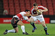 Captain of the British&Irish Lions, Brian O'Driscoll gets past Andre Pretorius of the Xerox Lions.<br /> Rugby - 090602 - British&Irish Lions v Xerox Lions - Coca-Cola Park - Johannesburg - South Africa. The British Lions won 74-10 scoring 10 tries.<br /> Photographer : Anton de Villiers / SASPA