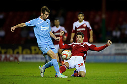 Swindon Defender Raphael Rossi Branco (BRA) is tackled by Plymouth Midfielder Tyler Harvey (ENG) during the second half of the match - Photo mandatory by-line: Rogan Thomson/JMP - Tel: Mobile: 07966 386802 08/10/2013 - SPORT - FOOTBALL - County Ground, Swindon - Swindon Town v Plymouth Argyle - Johnstone Paint Trophy Round 2.