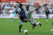 Swansea city's Wayne Routledge © is sent flying by West Ham's James Collins. Barclays Premier league, Swansea city  v West Ham Utd at the Liberty Stadium in Swansea, South Wales  on Saturday 25th August 2012. pic by Andrew Orchard, Andrew Orchard sports photography,