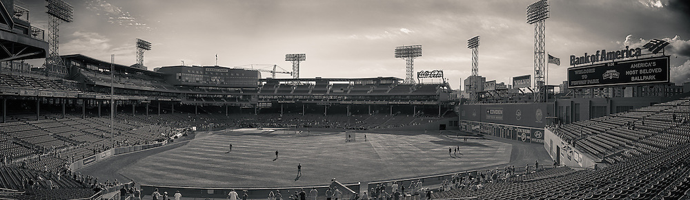 [Note: This panoramic photo was created by stitching together multiple exposures during post-processing and also creating a high dynamic range photo from a single exposure during post-processing.  Other tone effects were applied during post-processing as well.] A panoramic view of Fenway Park during batting practice before a game between the Minnesota Twins and Boston Red Sox on August 3, 2012 in Boston, Massachussetts.