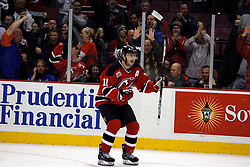 Apr 3, 2007; East Rutherford, NJ, USA; New Jersey Devils center John Madden (11) celebrates his game winning goal in the overtime shootout at Continental Airlines Arena in East Rutherford, NJ.