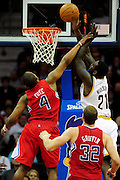 Feb. 11, 2011; Cleveland, OH, USA; Los Angeles Clippers guard Randy Foye (4) fouls Cleveland Cavaliers power forward J.J. Hickson (21) during the fourth quarter at Quicken Loans Arena. The Cavaliers broke their loosing streak beating the Clipper 126-119 in overtime. Mandatory Credit: Jason Miller-US PRESSWIRE