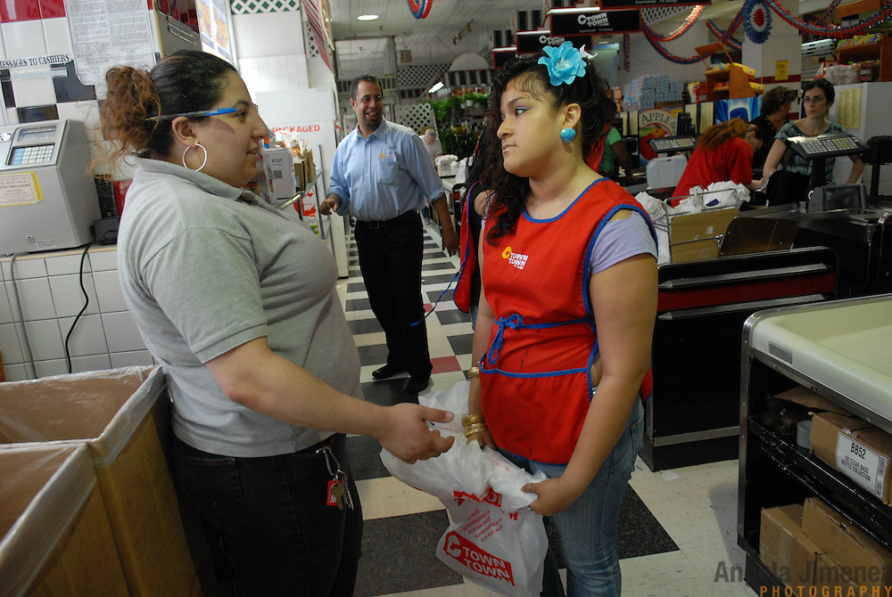 DATE: 6/8/07<br /> DESK: CTY<br /> SLUG: CTOWN<br /> ASSIGN ID: 30044113A<br /> <br /> Store Manager Rita Barsoum, left,  talks with employee Krystal Leon, 17,  during her cashier shift at Steve's C-Town, a grocery store on 9th Street between 5th and 6th Avenues in Park Slope, Brooklyn on June 8, 2007. <br /> <br /> &quot;We've had to send her home three times&quot; (for using her text messaging at work), says Barsoum, 21.<br />  <br /> photo by Angela Jimenez for The New York Times<br /> photographer contact 917-586-0916