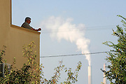 Israel, Hadera, The smoke emitting coal operated power plant's flues as seen from a residence's home