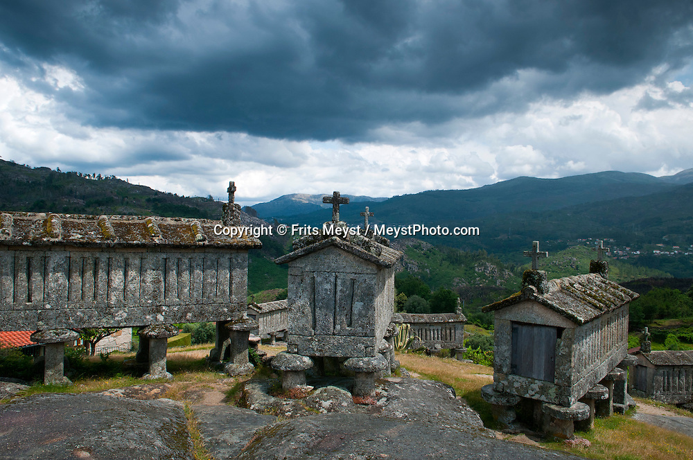 Soajo, Peneda Geres National Park, Portugal, June 2011.  The Granaries, espigueiros of Soajo. Small hamlets, evergreen gardens and vineyards mark the Soajo area.  In the extreme North of Portugal, between the Atlantic Coast and the Spanish border are the mountains and valleys of Peneda Geres National Park. Walk along narrow shepherd trails or on the ancient cement of Roman roads. From lush river valleys to bare rocky mountain peaks.  Photo by Frits Meyst/Adventure4ever.com
