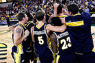 26 November 2005: Marquette celebrates their 92-89 overtime victory over the University of South Carolina Gamecocks to win the championship at the Great Alaska Shootout in Anchorage, Alaska..