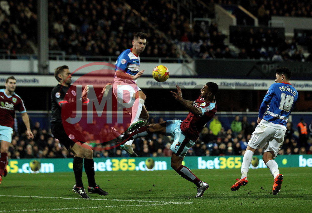 Andre Gray of Burnley sees the ball cleared away by Grant Hall of Queens Park Rangers - Mandatory byline: Robbie Stephenson/JMP - 12/12/2015 - Football - Loftus Road - London, England - Queens Park Rangers v Burnley  - Sky Bet Championship