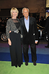 GERALDINE LYNTON-EDWARDS and MICHAEL WINNER arrive at the press night of the new Andrew Lloyd Webber  musical 'The Wizard of Oz' at The London Palladium, Argylle Street, London on 1st March 2011 followed by an aftershow party at One Marylebone, London NW1