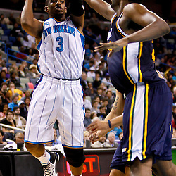 December 17, 2010; New Orleans, LA, USA; New Orleans Hornets point guard Chris Paul (3) is defended by Utah Jazz center Al Jefferson (25) during the second half at the New Orleans Arena.  The Hornets defeated the Jazz 100-71. Mandatory Credit: Derick E. Hingle