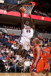 Virginia guard/forward Solomon Tat (45) shoots over Clemson guard Terrence Oglesby (22).  The Virginia Cavaliers men's basketball team fell the Clemson Tigers at 82-51 the John Paul Jones Arena in Charlottesville, VA on February 7, 2008.
