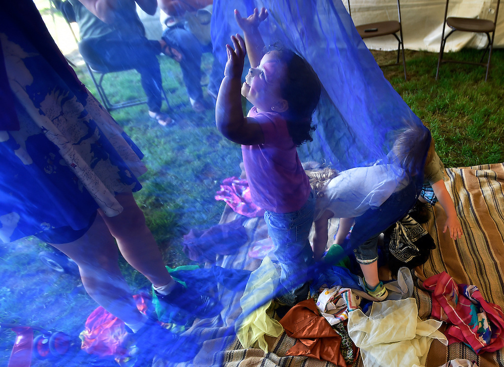 Dija Betts, 2, plays under a silk scarf at the Children's Music Tent at the Fine Arts Fiesta on opening day. 5/19/2016 Aimee Dilger|Times Leader