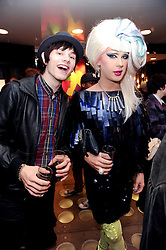 Left to right, LUKE WORRELL and JODIE HARSH at a party to celebrate the Firetrap Watches and Kate Moross Collaboration Launch, held at Firetrap, 21 Earlham Street, London, UK on 13th October 2010.