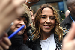 Spice Girl Melanie Chisholm is surrounded by fans outside Global Radio studios in Leicester Square, London.