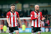Brentford striker, Scott Hogan (9) and Brentford midfielder, Alan McCormack (12) walking off after game during the Sky Bet Championship match between Brentford and Bristol City at Griffin Park, London, England on 16 April 2016. Photo by Matthew Redman.